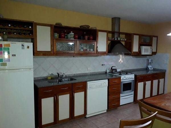 Muebles de cocina con materiales vidrio y acero